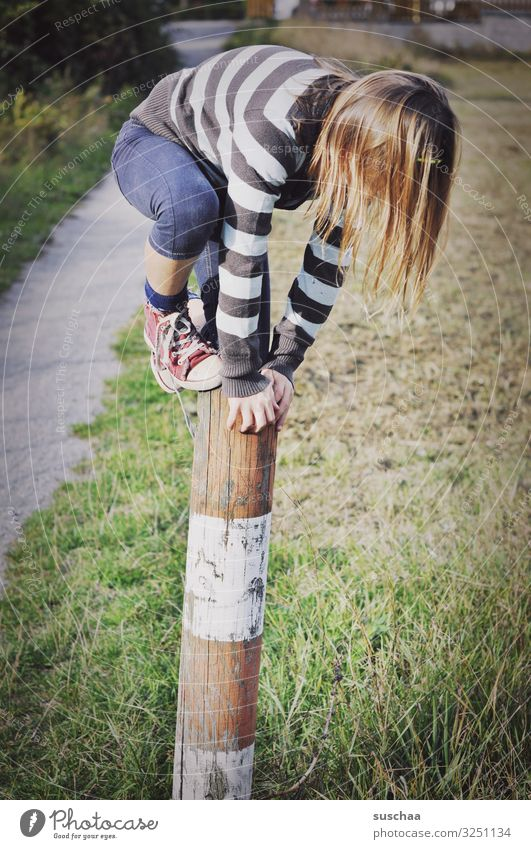 climber (2) Child Girl boyish Climbing Playing Reckless Pole Wooden stake Fence post To hold on Exterior shot Footpath Nature Romp Infancy Dexterity