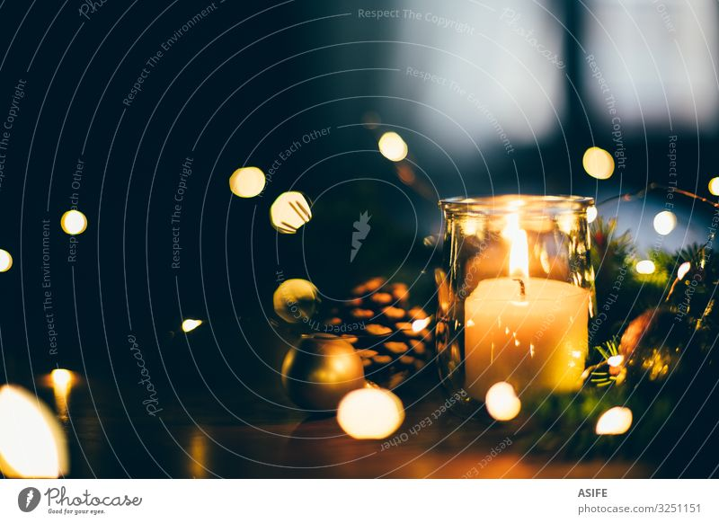 Christmas mood at home with candle and lights Winter Decoration Table Feasts & Celebrations Christmas & Advent Warmth Tree Candle Glittering Dark Natural Gold