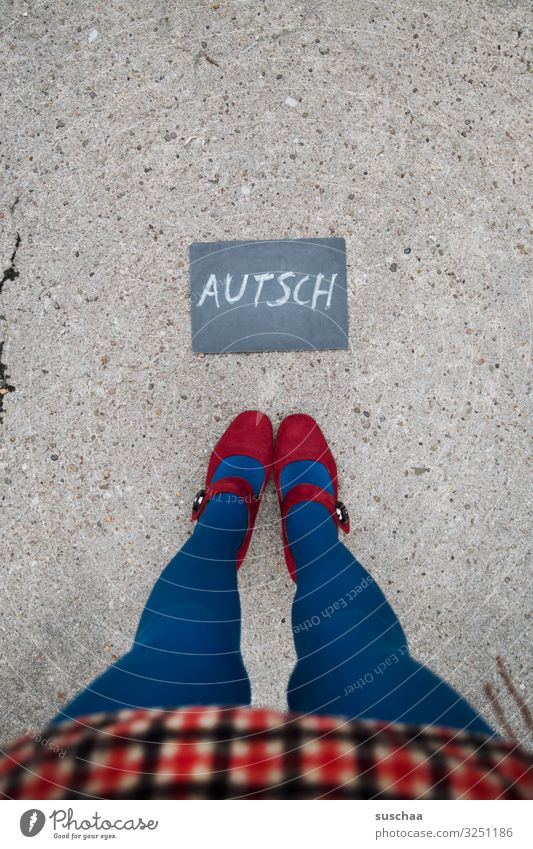 after the fall .. Text Word Letters (alphabet) Autsch Hurt Pain Blackboard Clue Information Communication Woman Legs Skirt feminine Street feet Asphalt