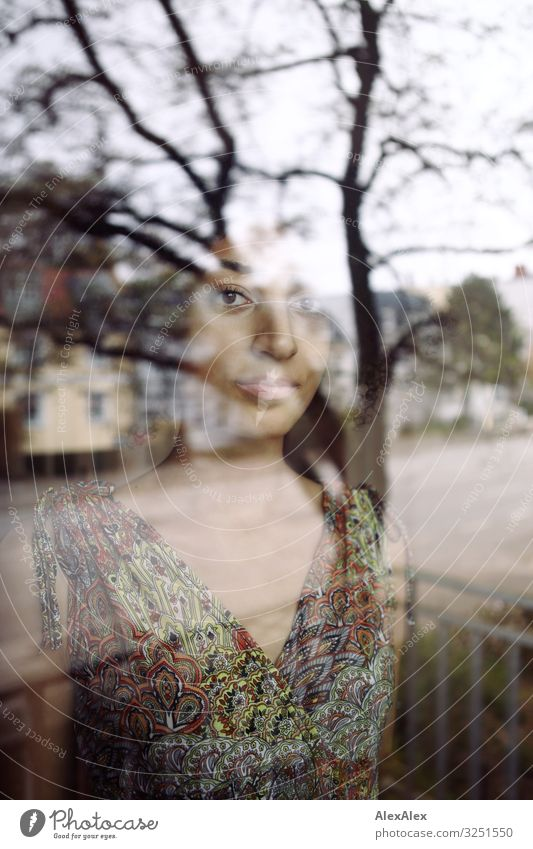Portrait of a woman behind a window pane Style Beautiful Harmonious Flat (apartment) Town Window Young woman Youth (Young adults) 18 - 30 years Adults