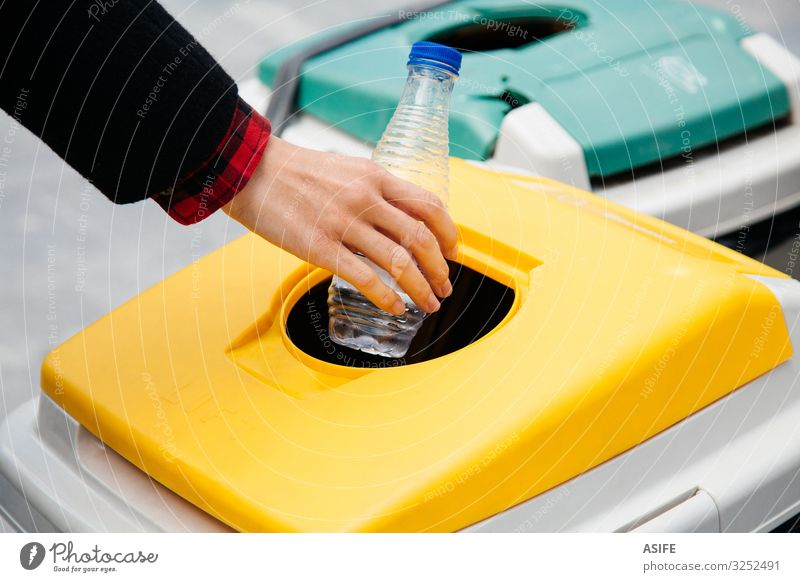 Recycling plastic in the street Woman Hand Street Adults Yellow Environment Friendliness Plastic Trash Bottle Ecological Container Putt Separate