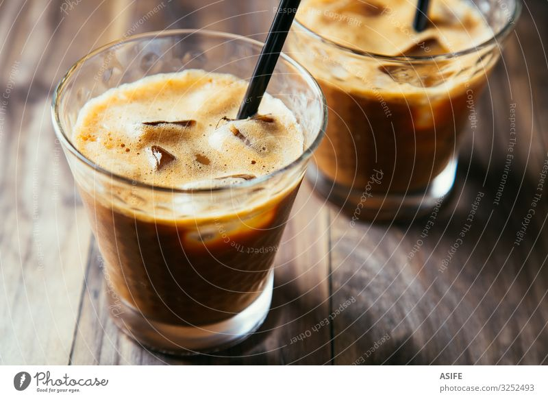 Glasses of iced coffee latte Dessert Beverage Coffee Summer Table Restaurant Wood Dark Fresh Delicious Brown Iced coffee milk Milkshake cold glass ice cubes
