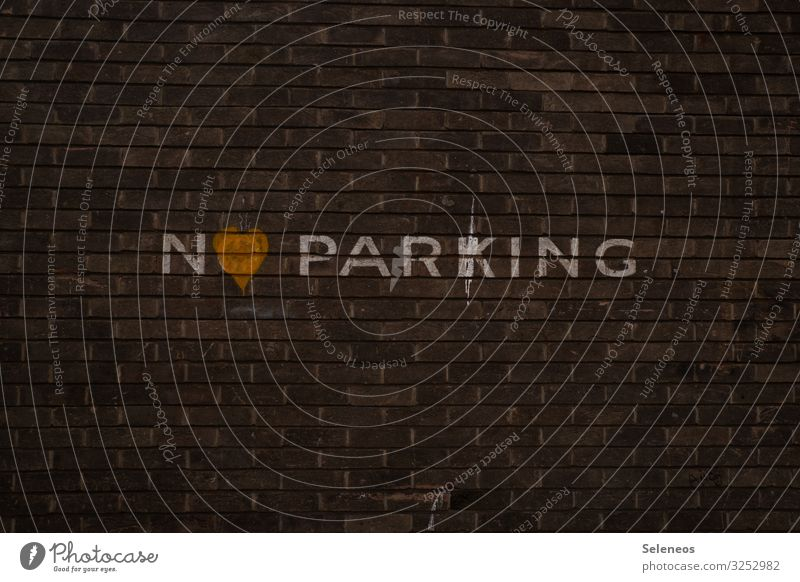No parking with heart Manmade structures Building Wall (barrier) Wall (building) Facade Sign Characters Signs and labeling Signage Warning sign Road sign