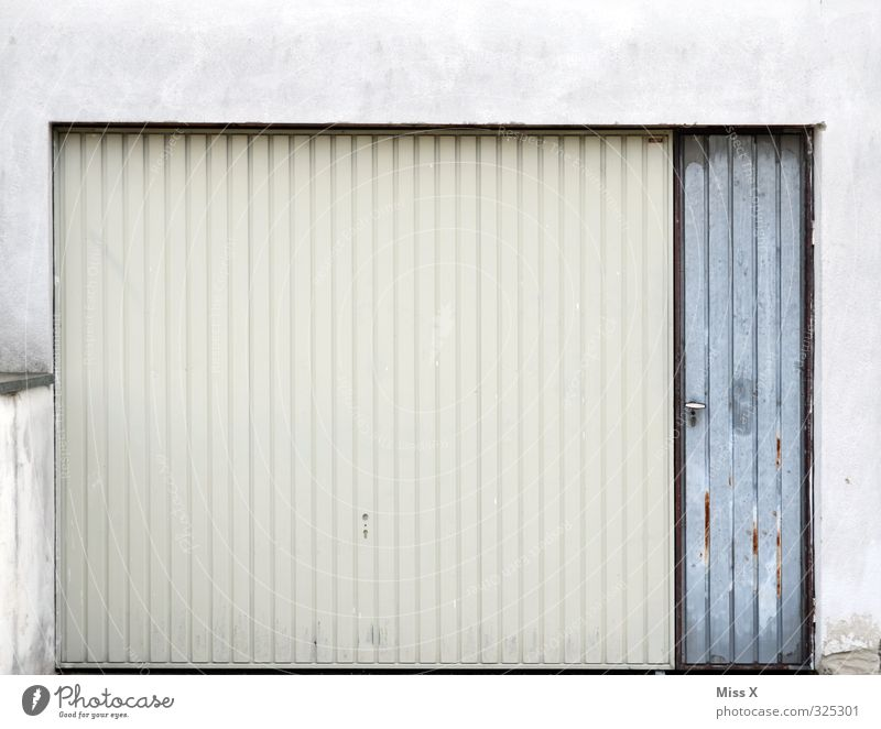 garage Flat (apartment) Gloomy Gray White Garage Garage door Gate Closed Colour photo Subdued colour Exterior shot Deserted Copy Space top Copy Space middle