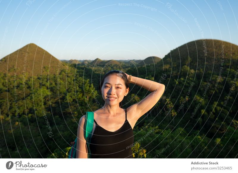 Happy woman standing on observation deck on hill fence young happy adventure smile tourist female ethnic asian cheerful joyful green mountain hike nature