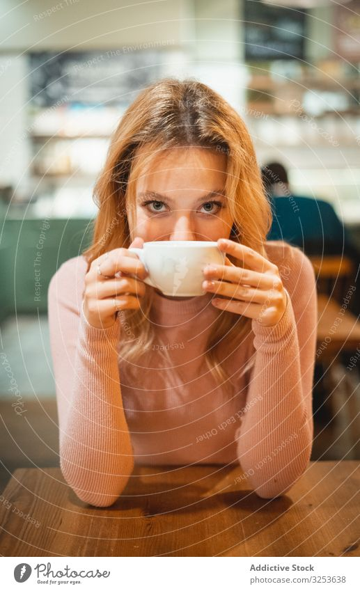 Woman having a cup of coffee woman cafe drink smartphone using smile modern female browsing device gadget social media surfing watching delighted happy cheerful