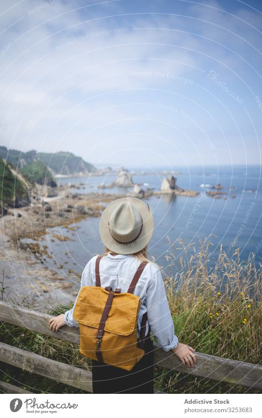Faceless lady looking on bay from hill woman sea landscape seascape water coast shore contemplate relax rest chill traveler distance freedom explore recreation