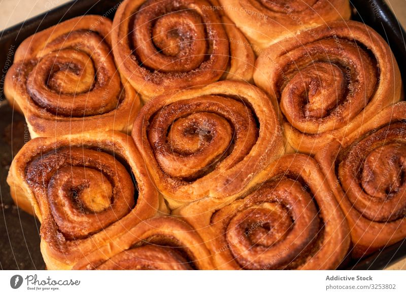 Tasty homemade rolls on baking tray dessert pastry food bun cookie delicious frosting domestic cooking gastronomy tasty bakery baked flavor natural fresh