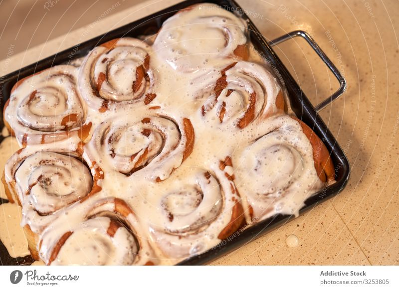 Delicious homemade rolls with icing on baking tray bun dessert pastry glaze food cookie delicious frosting domestic cooking gastronomy tasty sweet bakery liquid