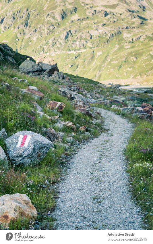 Empty narrow path in valley dirt mountain green rural ground nature travel cloud landscape nobody way trip scenic empty switzerland hill scenery rock journey