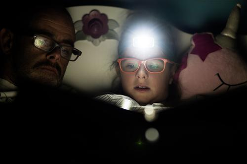 Headlamp, girl, reading Education Girl Father Adults 2 Human being Eyeglasses Moustache headlamp Discover Relaxation To enjoy Reading Illuminate Lie Looking