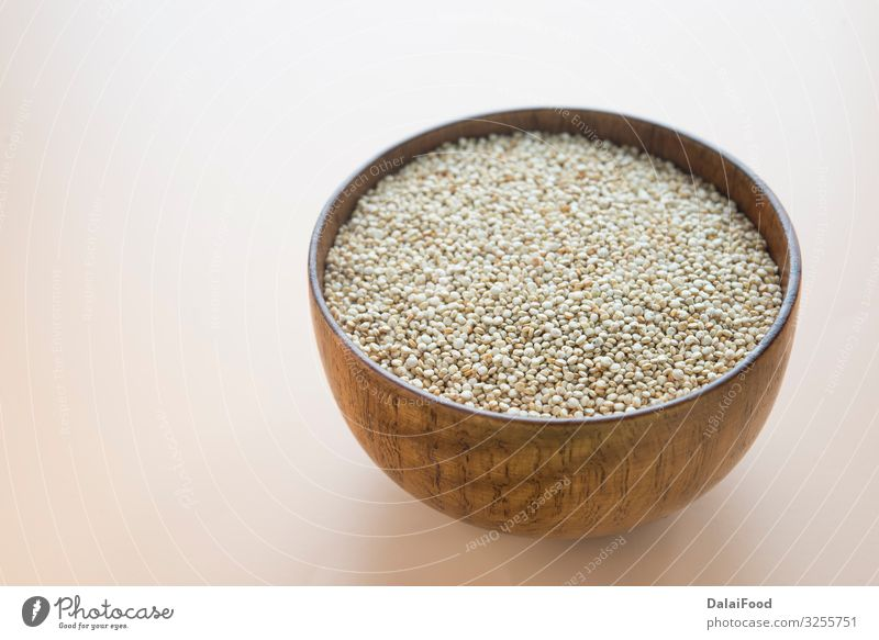White Quinoa Seeds in wooden bowl Nutrition Bowl Wood Fresh Healthy Chenopodium background brown background Cereal dietary dieting food grain groats health