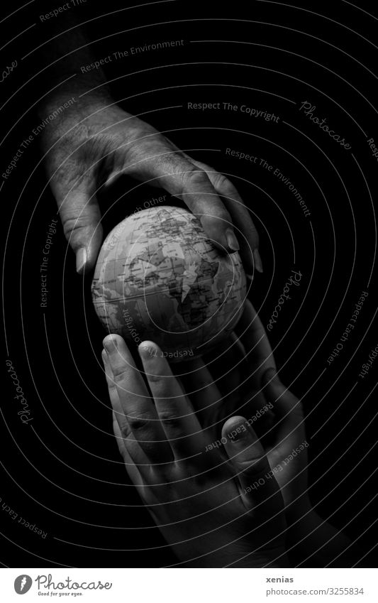 Mature hand gives grey globe to young hands Woman Man Youth (Young adults) Senior citizen by hand Fingers 2 Human being Environment Earth Climate change Globe