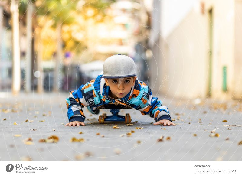 Cute little kid stretched on a skateboard Lifestyle Joy Happy Leisure and hobbies Playing Board game Vacation & Travel Summer Winter Entertainment Sports Child