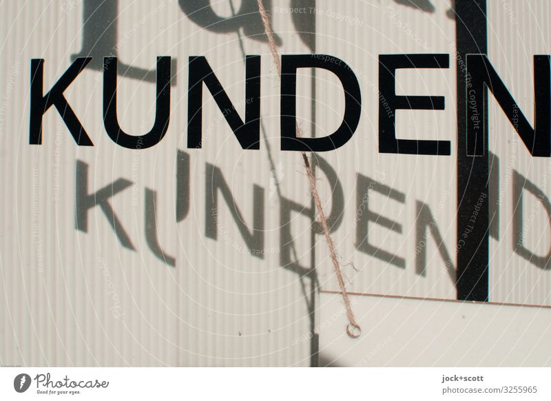 customers Trade Services Customer area Beautiful weather Berlin Shop window String Signs and labeling Glass Word Reliability Warmth Black White Moody Attentive