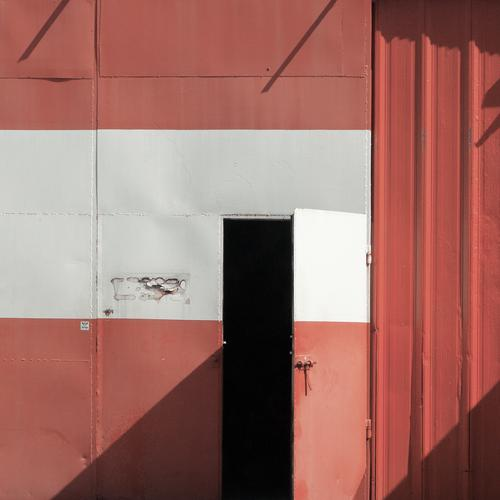 patriotism Poland Eastern Europe Gate Door Garage Garage door Metal Old Simple Red Black White Open Patriotism national colors flag of the country Colour photo