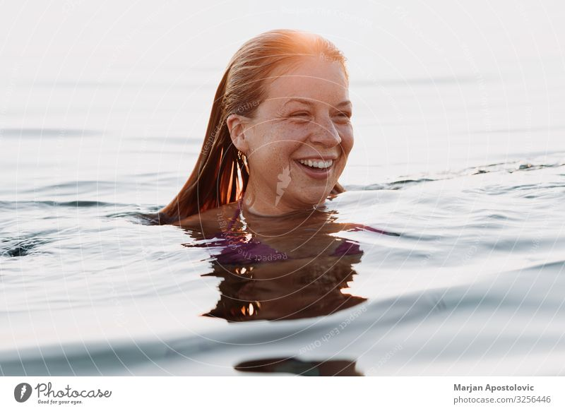 Young happy woman swimming in the sea in sunset Lifestyle Joy Vacation & Travel Tourism Freedom Summer Summer vacation Human being Feminine Young woman