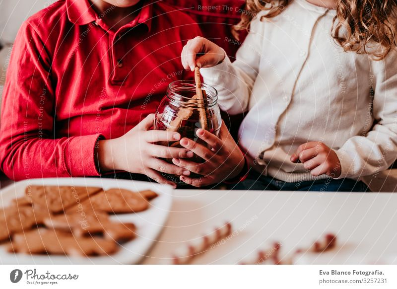 beautiful brother and sister at home having a delicious snack. Christmas concept Snack Cookie Candy Brother Sister siblings Christmas & Advent Home Blonde