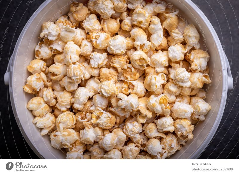 Popcorn in bucket Food Candy Nutrition Fast food Finger food Healthy Eating Select Observe To enjoy Fresh Nibbles Bucket Colour photo Interior shot Studio shot