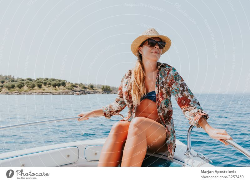 Young woman enjoying on the boat Lifestyle Joy Vacation & Travel Tourism Adventure Freedom Cruise Summer Summer vacation Ocean Human being Feminine