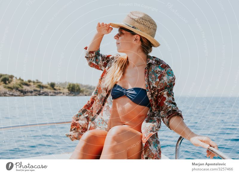 Young woman enjoying a day on the boat Lifestyle Joy Vacation & Travel Tourism Adventure Freedom Cruise Summer Summer vacation Ocean Waves Human being Feminine