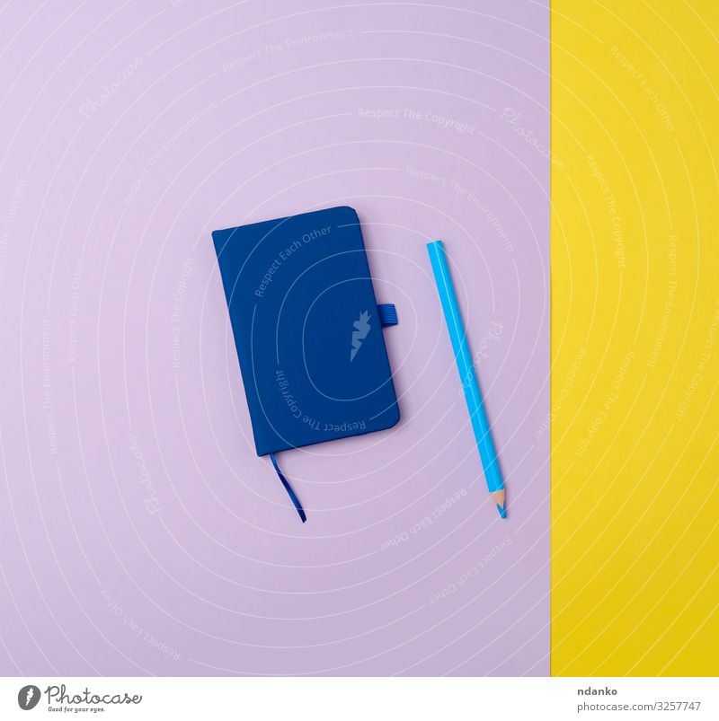 closed notebook and wooden blue pencil Business Pen Wood Write Above Blue Yellow Colour Idea background Blank Conceptual design Diary Document educate education