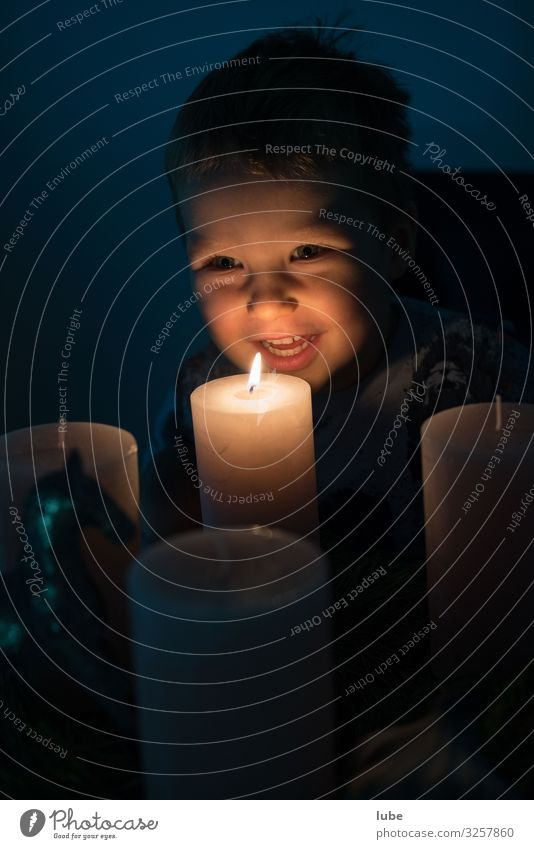 Advent light Boy (child) 1 Human being 1 - 3 years Toddler Happiness Christmas & Advent advent wreath Light Flare Candlelight christmas laugh children