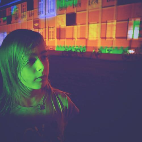 at night in green light Child Girl Night Multicoloured Light colourful light Illuminate Event Visual spectacle Lighting Building Face Green Exceptional