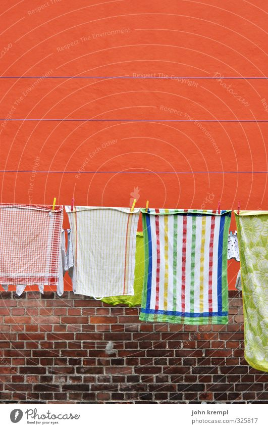 The little bit of household Wall (barrier) Wall (building) Towel Dish towel Clothesline Brick Stone Hang Fragrance Clean Orange Joie de vivre (Vitality)