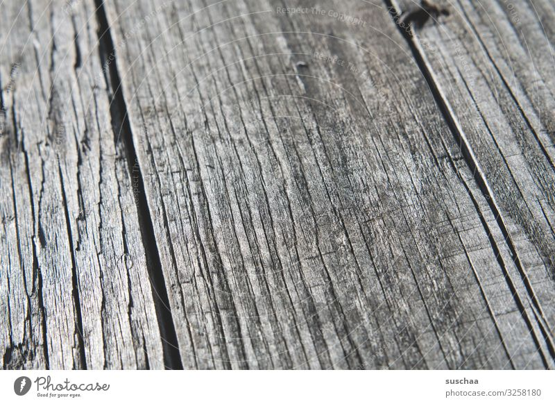 Woody Wooden board wooden planks Wooden table Wooden bench Detail Close-up Thread-like running direction Splinter Furrow Combustible Firewood Old restore
