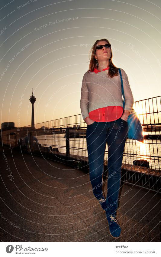 birthday boy Duesseldorf Esthetic Back-light Young woman Television tower Rhine Sunset Romance To go for a walk Colour photo