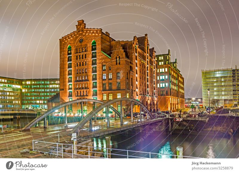 Speicherstadt at night in Hamburg Beautiful Office Landscape Sky Town Bridge Building Architecture Old Historic Blue Advertising Canal brick clinker Elbe