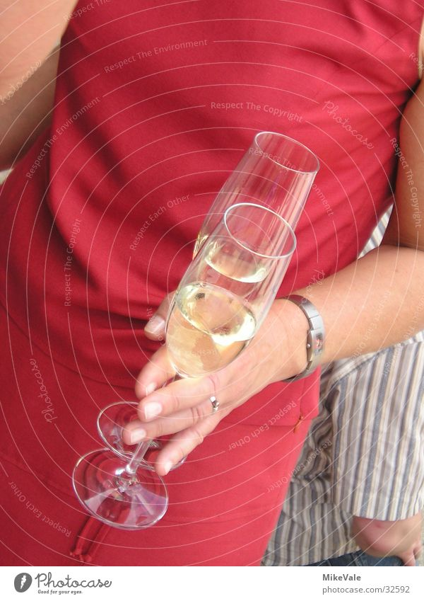 Another champagne? Sparkling wine Glass Woman Hand Nutrition Alcoholic drinks Party To pop the corks Party mood Party guest Party goer 2 Red Detail