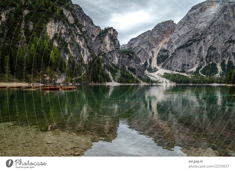 Boating Leisure and hobbies Vacation & Travel Tourism Trip Adventure Environment Nature Landscape Clouds Rock Alps Mountain Dolomites Lake Pragser Wildsee Lake