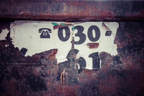Call me Container Metal Steel Rust Sign Digits and numbers Signs and labeling Signage Warning sign Dark Black White Telephone Telephone number Berlin 0 3 30