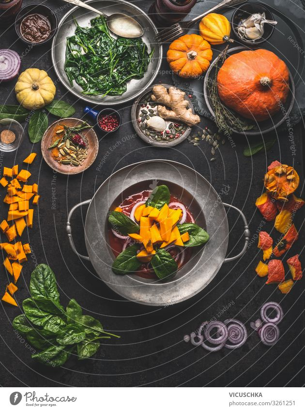 Cooking of seasonal vegetarian meals for autumn and winter Winter Thanksgiving Eating cooking pumpkin spinach ginger onion top view healthy food concept above