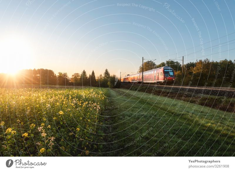 Red train and spring landscape at sunrise. Spring travel context Vacation & Travel Environment Nature Landscape Sunrise Sunset Transport Public transit Vehicle