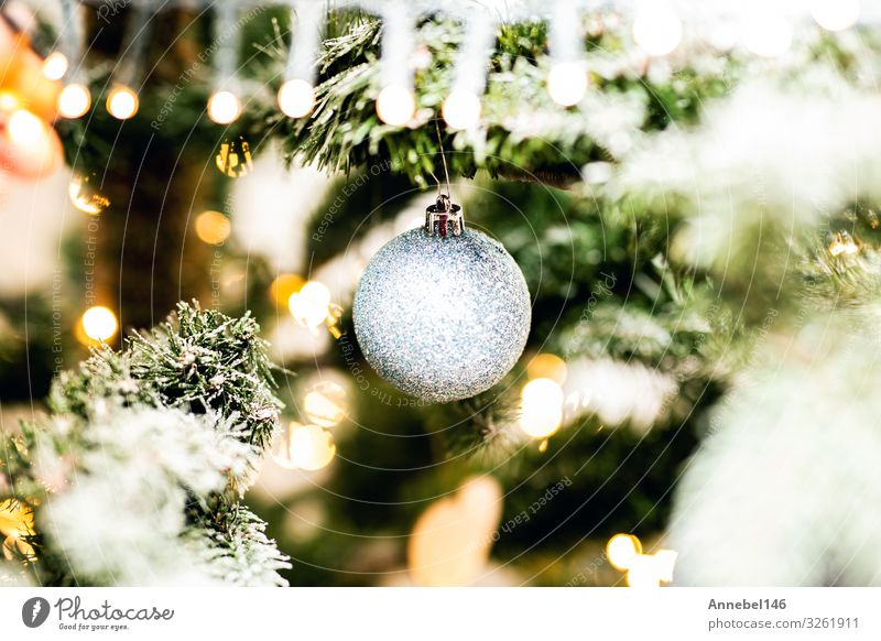 Shiny christmas decoration in Christmas tree covered with snow Design Beautiful Winter Snow Decoration Feasts & Celebrations Christmas & Advent New Year's Eve
