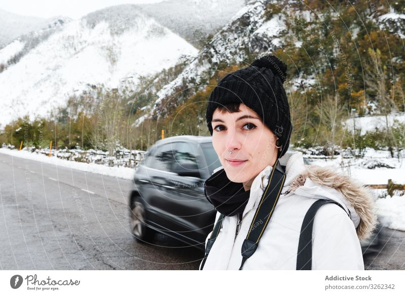 Woman visiting mountains in winter woman road walk vacation snow nature tourist adventure travel female landscape cold trekking activity explore environment