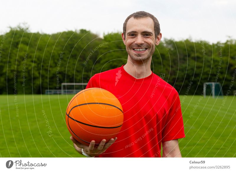 Young man with basketball Lifestyle Summer Sports Human being Park Fitness Player basketball player out Sporting grounds workout Man Athletic Laughter kind Red