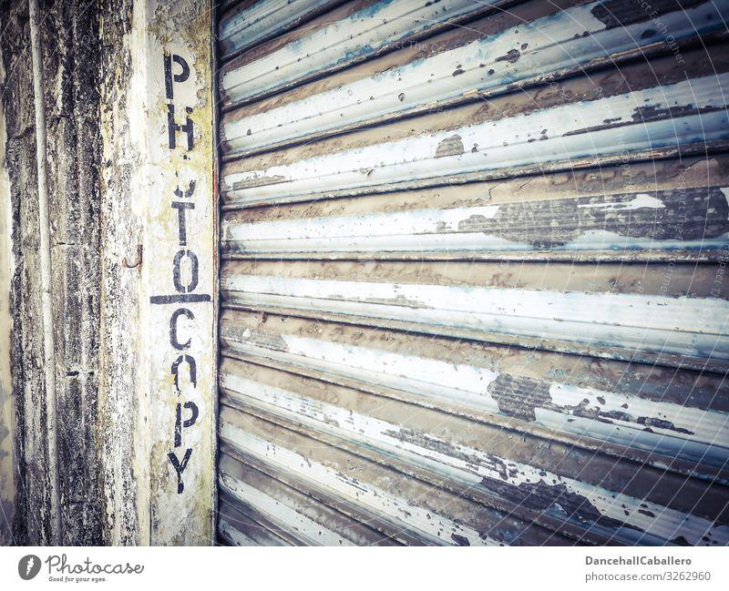written word photocopy on a garage door Garage door Roller shutter Photocopier Town Downtown Broken Services Decline Wall (barrier) Wall (building) Facade Old