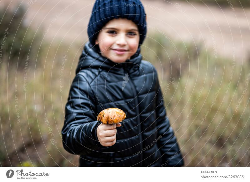 Lttle kid with a mushroom. Focus on mushroom Child Human being Vacation & Travel Nature Beautiful Hand Joy Forest Winter Mountain Face Lifestyle Autumn Natural