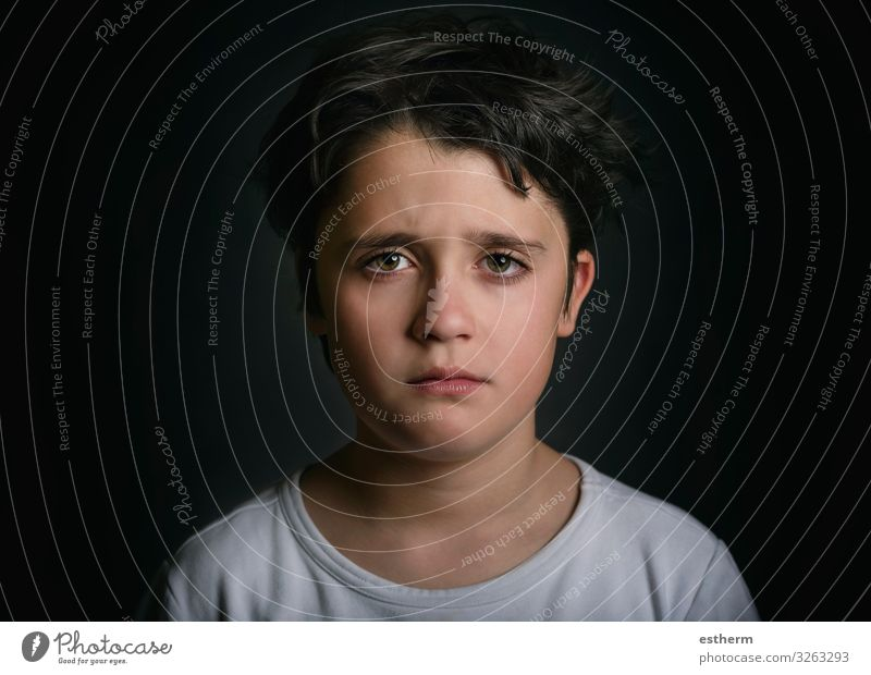 Portrait of sad child on black background Human being Child Boy (child) Infancy 1 8 - 13 years Think Sadness Cry Gloomy Emotions Hope Pain Loneliness Guilty