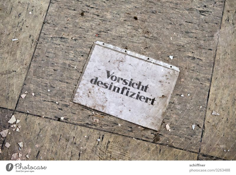 Characters Dirty Signage Floor covering Trash Strange Caution Lie (Untruth) Warn Paving tiles Warning sign Illogical Disinfection Ground level Cling wrap