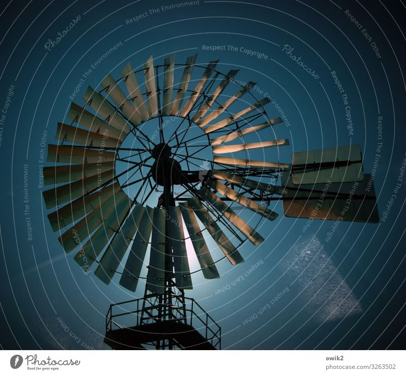 twister Technology Energy industry Wind energy plant Pinwheel Cloudless sky Sun Beautiful weather Metal Movement Rotate Illuminate Old Exceptional Gigantic