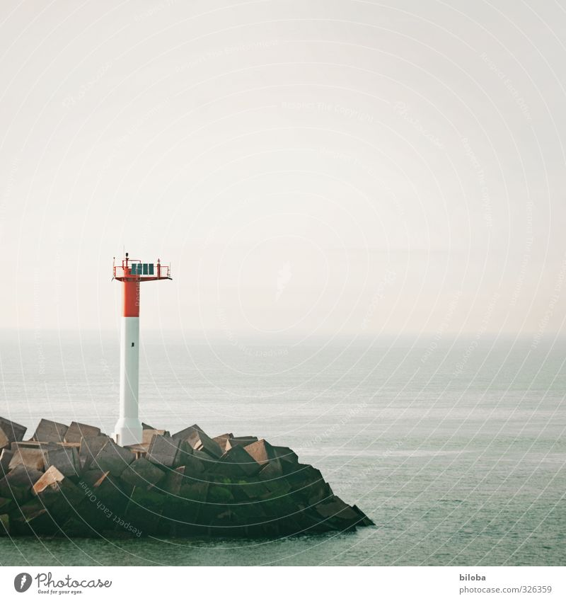 Lighthouse at the port exit into the uncertain infinity of the North Sea veiled by fog harbour exit Harbour Signal North Sea coast Ocean Fog Shroud of fog