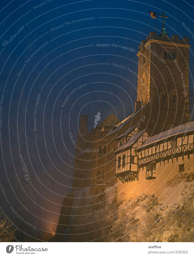snow flurries Castle Cold Snowfall Wartburg castle Half-timbered facade Tower Winter Colour photo Copy Space left Copy Space top