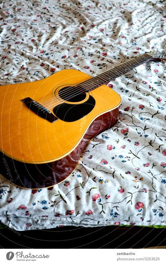 Guitar on the bed Musical instrument Song Lie Bed Bedclothes Pattern Flower Romance Deserted Copy Space