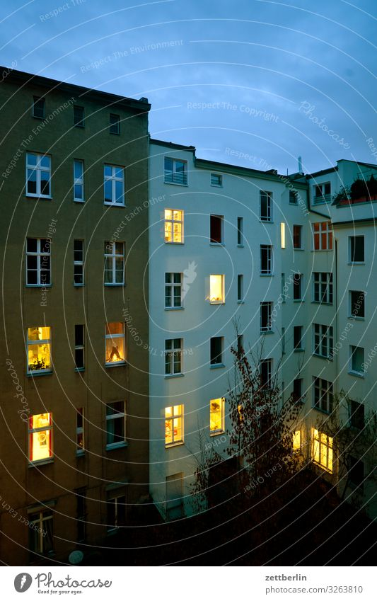 Ten illuminated windows Evening Old building Dark Twilight Facade Window House (Residential Structure) Sky Heaven Behind Backyard Courtyard Interior courtyard
