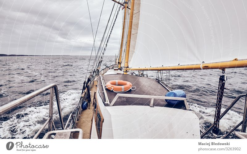 Sailing old schooner on a stormy weather. Lifestyle Vacation & Travel Tourism Adventure Far-off places Freedom Cruise Ocean Sky Horizon Weather Storm Wind